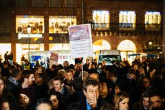 People gathering in solidarity with victims from Paris assaults - stock photo