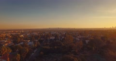 Aerial pan around Los Angeles cityscape at sunset. 4K UHD. - stock footage
