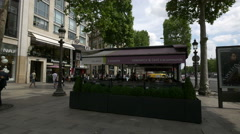 Sitting at Pomme de Pain bakery and outdoor restaurant on Champs-Elysees, Paris Stock Footage