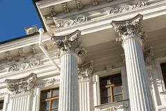 Columns on blue sky background - stock photo