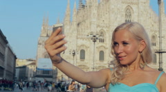 Beautiful lady clicling selfie on phone near Piazza Duomo Arkistovideo
