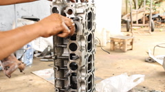 Mechanic is cleaning the engine of car by use oil stain remover or engine cleane Stock Footage