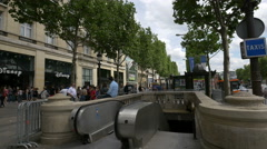 Sitting on the entrance to a Metro station on Avenue des Champs-Elysees, Paris Stock Footage