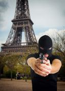 Terrorist with face covered in Paris - stock photo