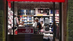 Street View of Shoppers Paying Cashier in Clothing Store Stock Footage