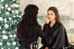 Stock Photo of Make-up master doing visage in studio