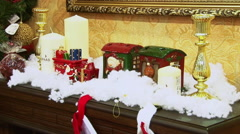 Shining elegant tree and toys on a fireplace. - stock footage