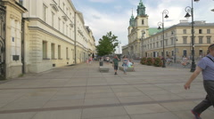 Riding bikes and walking in front of University of Warsaw, Warsaw Stock Footage