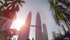 Beautiful topiaries in a garden beneath the famous Petronas twin towers Stock Footage