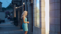 Girl looking on the storefront of trendy shops in milan Stock Footage