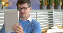 Man Having Video-Call with Tablet Stock Footage
