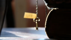 The label with the word love and a golden key on a bronze chain Stock Footage