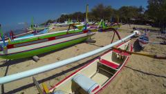 Stock Video Footage of Outrigger boats and canoes, standing by on ground in Bali, Indonesia