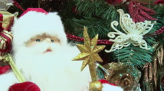Toy Santa Claus under the tree from gifts. - stock footage
