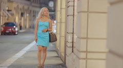 Stylish girl looking into luxury clothing stores Stock Footage