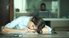 Businesswoman sleeping and waking up in office Stock Footage