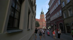 Royal Castle clock tower seen from Swietojanska street, Warsaw Stock Footage
