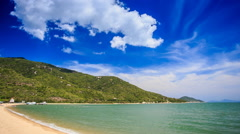 Stock Video Footage of cumulus cloud motion over hilly island beach azure sea