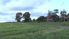 Countryside house in Sweden in traditional red wood Stock Footage