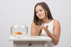 She asks goldfish fulfill the desire - stock photo