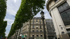 Imposing buildings on Avenue des Champs-Elysees cross to Rue La Boetie, Paris Stock Footage