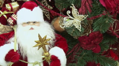 Toy Santa Claus under the tree from gifts. Stock Footage