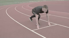 Portrait of the man running on the running track in slow motion sprinter  Stock Footage
