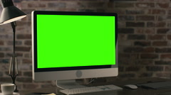 Footage of a computer monitor with green screen standing on a table Stock Footage