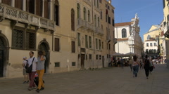 Young tourists walking near Santa Maria del Giglio Church in Venice Stock Footage