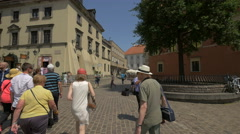 Group of elderly people heading to Castle Inn Hotel, Warsaw Stock Footage