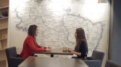 Two girls in  cafe smiling and talking Stock Footage