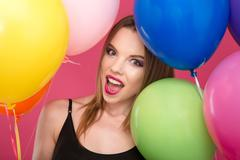 Closeup of excited glamour young female with colorful balloons - stock photo