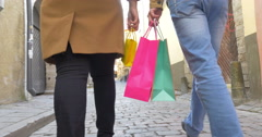People Walking in Tallinn with Shopping Bags Stock Footage