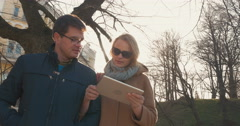 Couple with Tablet Walking in Tallinn Stock Footage