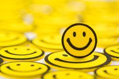 Yellow smiley magnet Stock Photos