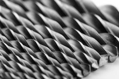 Drill bits isolated on white - stock photo