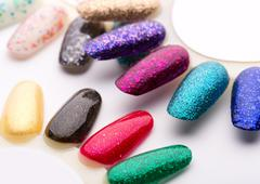 Nail polish in different fashion colors Stock Photos
