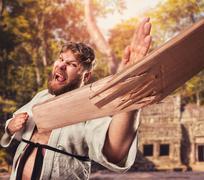 Karateka breaks board - stock photo