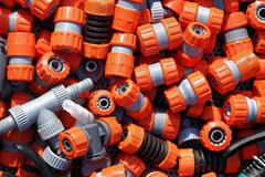 Large pile of plastic garden hose fittings Stock Photos