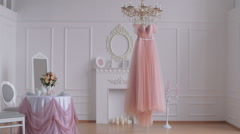 wedding dress hanging on the chandelier - stock footage