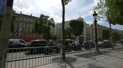 Riding motorcycles and driving cars on Avenue des Champs-Elysees, Paris Stock Footage