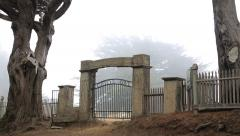 Stock Video Footage of Cemetery entrance graveyard fog eerie