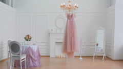 Wedding dress hanging on the chandelier Stock Footage