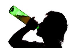 Silhouette of man drinking alcoho Stock Photos