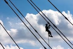 Silhouette of construction climber Stock Photos