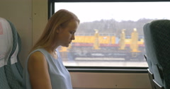 Woman Applying Make-up in Train Stock Footage
