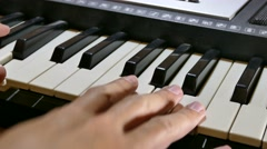Stock Video Footage of man playing piano synthesizer hand run over keys