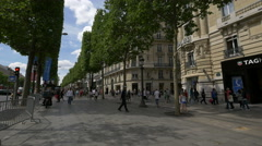 People crossing the Rue Washington, on Avenue des Champs-Elysees, Paris Stock Footage