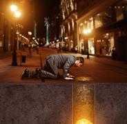 Businessman on knees found treasure - stock photo
