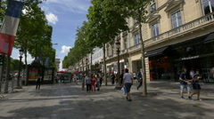 Walking by Automobiles Peugeot Car Dealer on Av. des Champs-Elysees, Paris Stock Footage